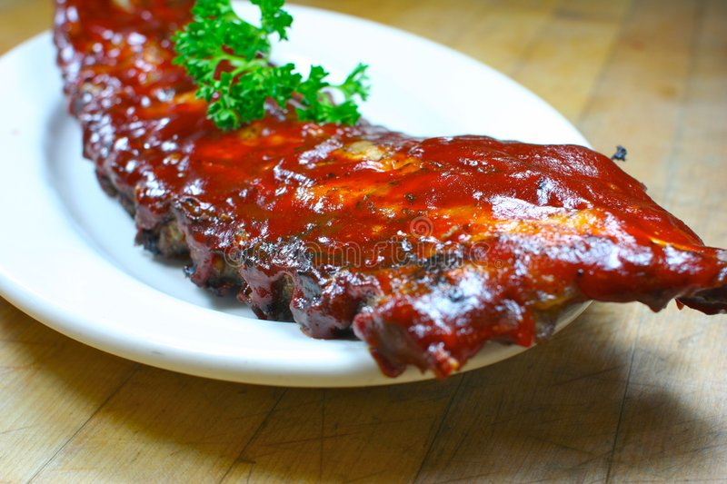Delicious pork ribs smothered. Full Slab of BBQ Ribs stock photo