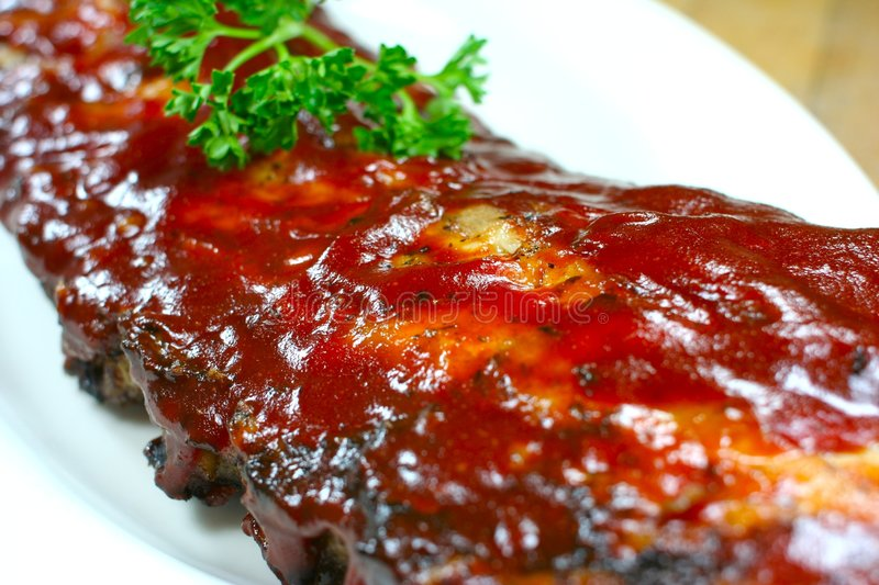 Delicious pork ribs smothered. Full Slab of BBQ Ribs stock photography