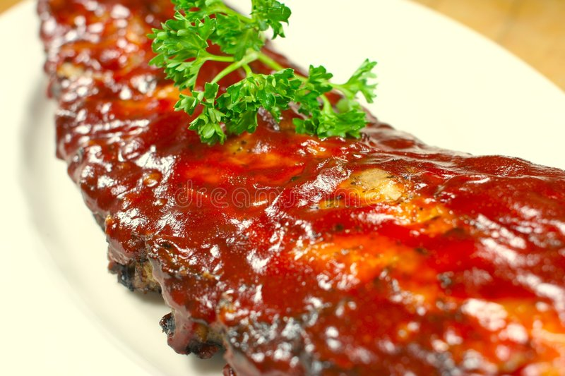 Delicious pork ribs smothered. Full Slab of BBQ Ribs royalty free stock photo