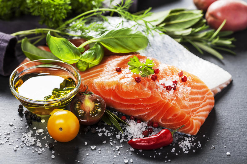 Delicious portion of fresh salmon fillet with aromatic herbs, stock photos
