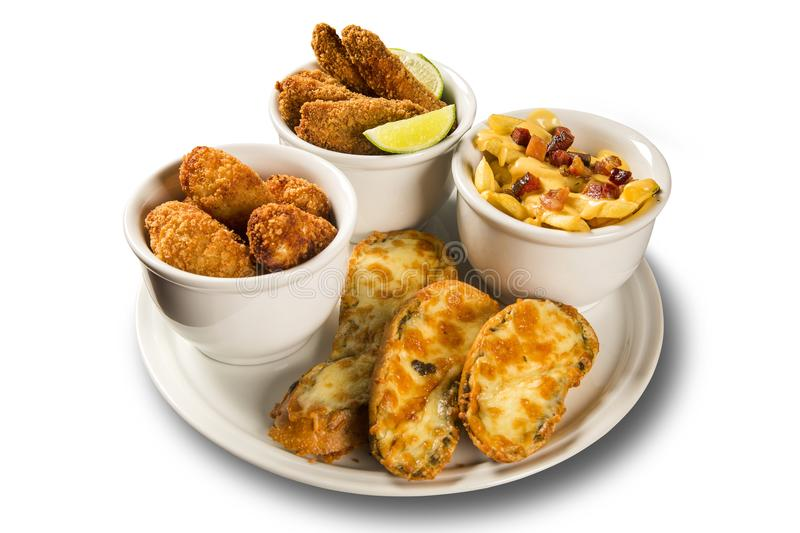Delicious portion of fried fish, fried chicken, french fries and cheese brunchetta. Delicious portion of fried fish, fried chicken, french fries and cheese stock image