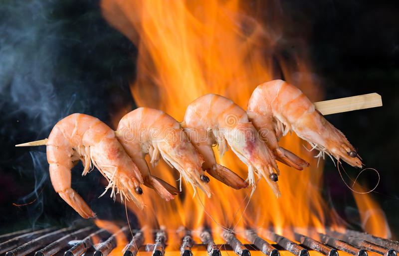 Delicious prawn skewer on garden grill royalty free stock images