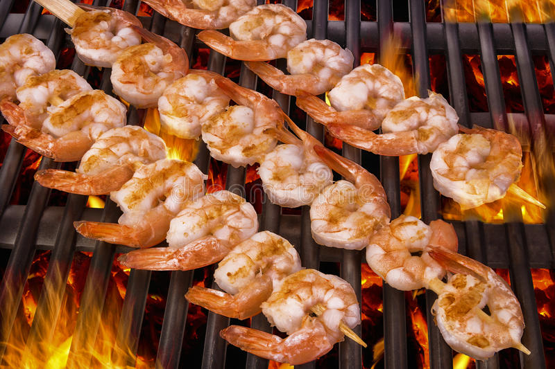 Delicious prawn spit on grill. With flames in background royalty free stock photo