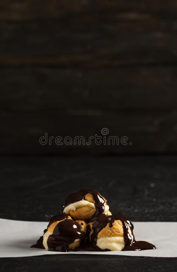 Delicious Profiterole on Wooden Table stock photography