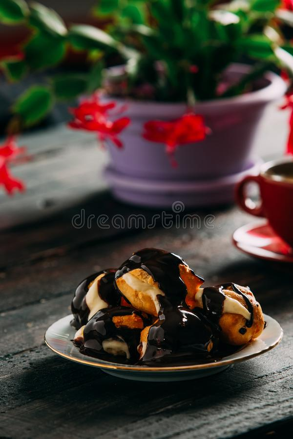 Delicious Profiterole on Wooden Table stock photo