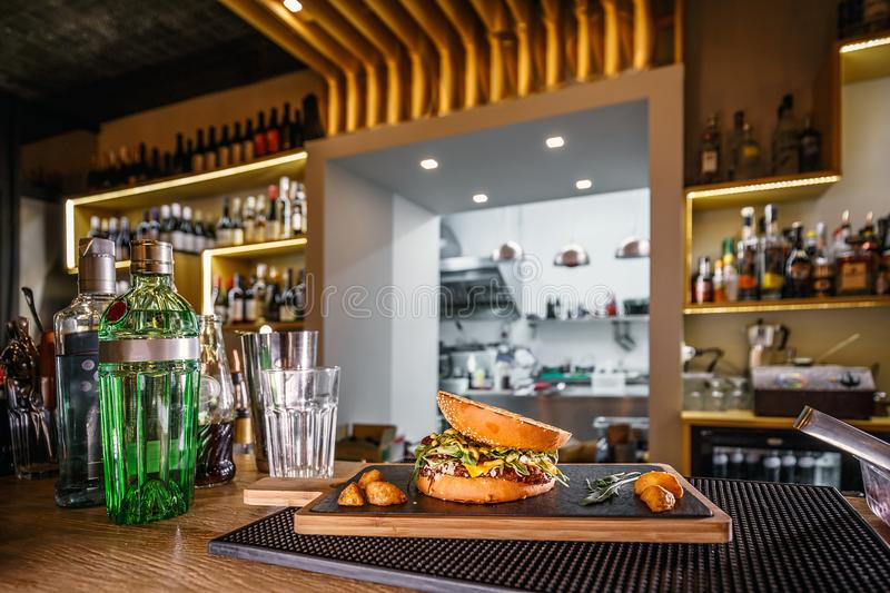 Delicious pub food. Burger served on slate board royalty free stock photography