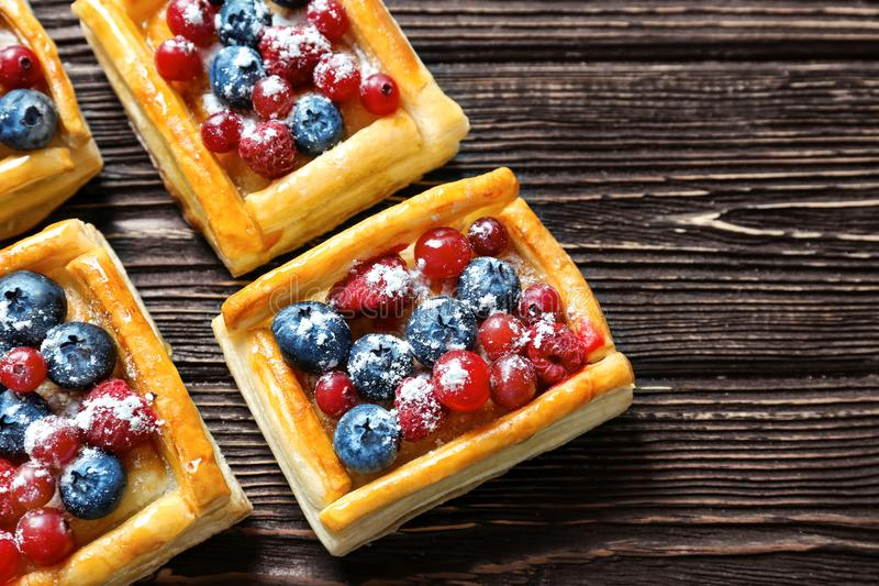 Delicious puff pastry dessert with berries royalty free stock photos