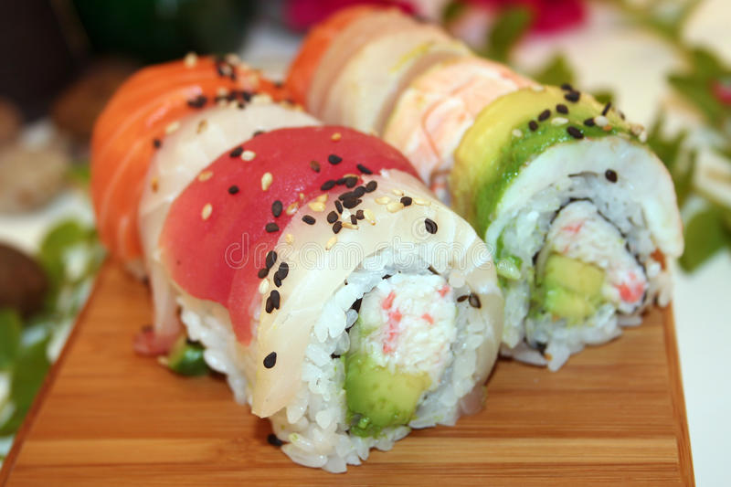 A Delicious Rainbow Roll of Colorful Sushi. A delicious rainbow roll of sushi includes tuna, shrimp, albacore, white fish, salmon avocado and more. A Japanese royalty free stock photography