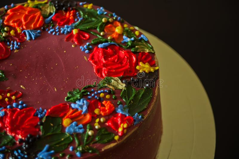 Delicious red cake with buttercream flowers on the black background stock images