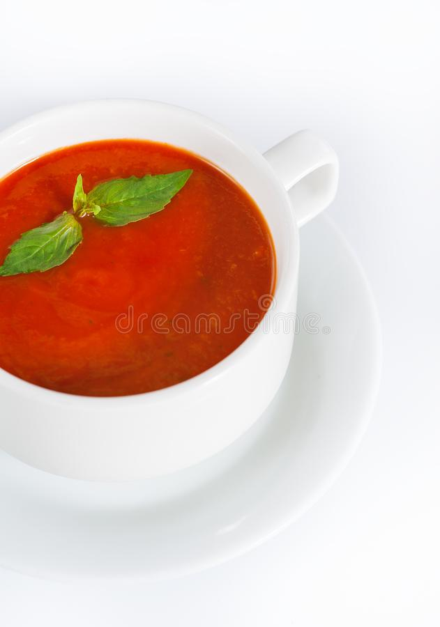 Delicious red tomato soup in bowl on white. Background stock image
