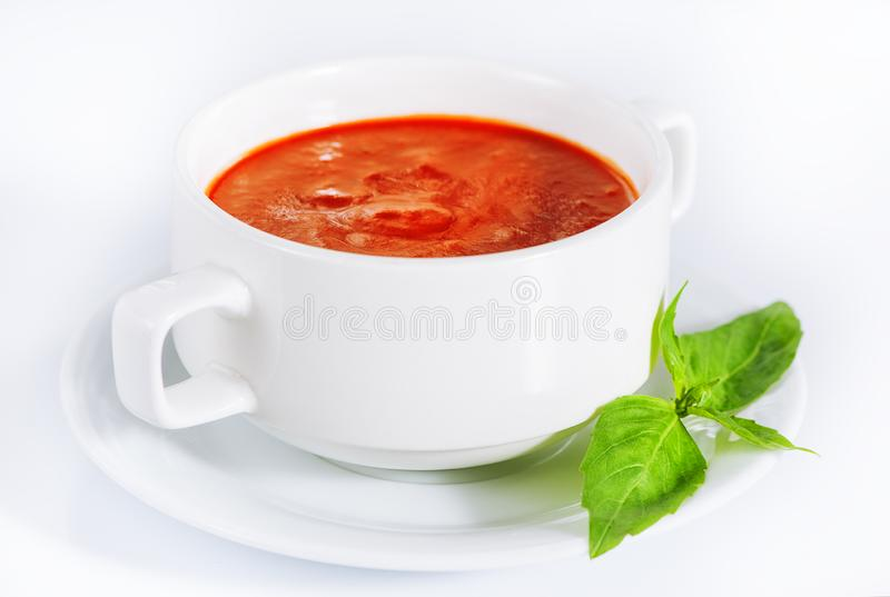 Delicious red tomato soup in bowl on white. Background stock images