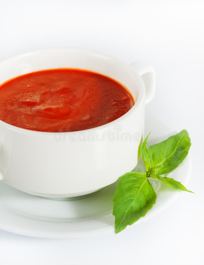 Delicious red tomato soup on white. Background stock photography