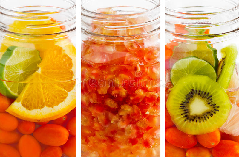 Delicious refreshing drink of mix fruits vibrant vertical stripes, infusion water. Delicious refreshing drink of mix fruits vertical stripes, infusion water royalty free stock photos
