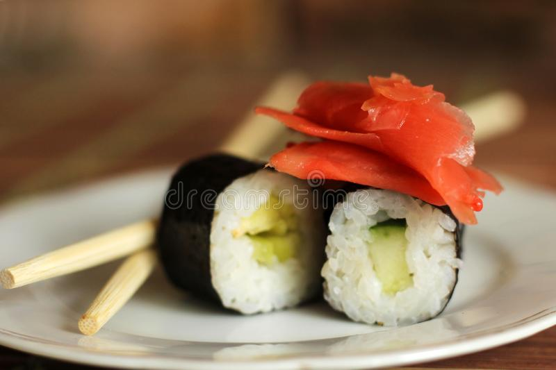 Delicious rice and fish rolls. Red ginger.Traditional Japanese cuisine royalty free stock photos
