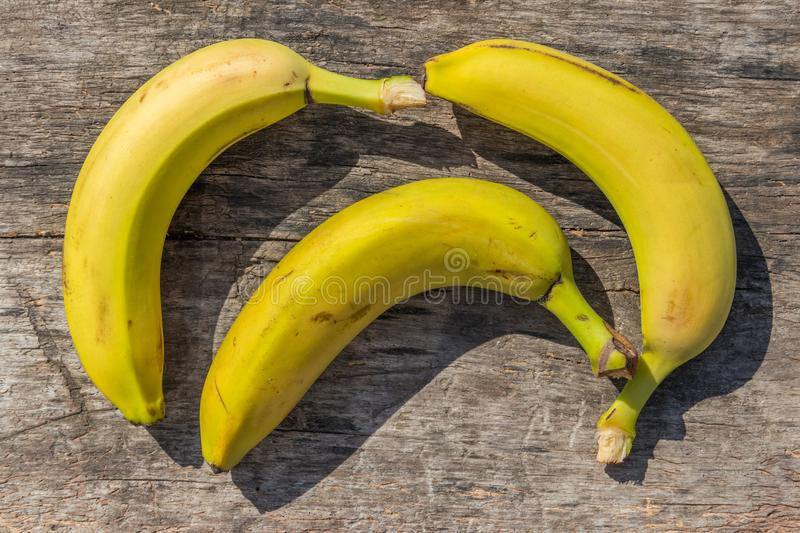 Delicious ripe yellow bananas on rustic wooden table stock photography