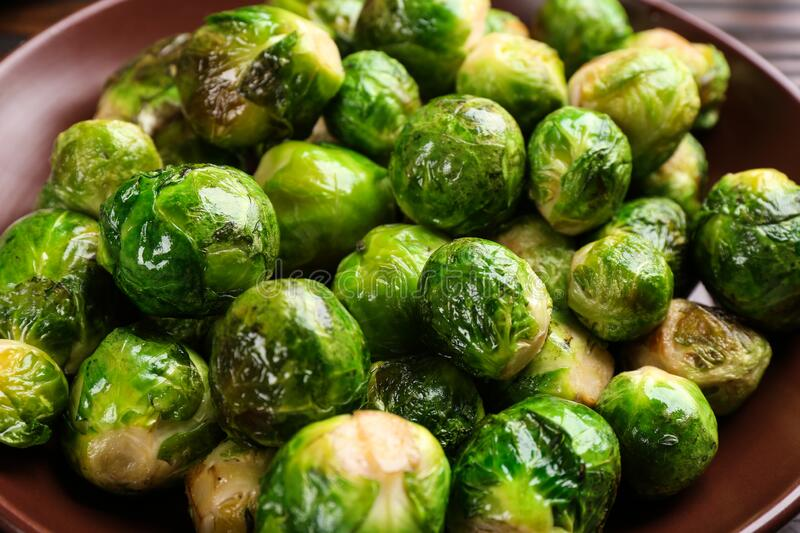 Delicious roasted Brussels sprouts in plate, closeup. Delicious roasted Brussels sprouts in plate royalty free stock photo