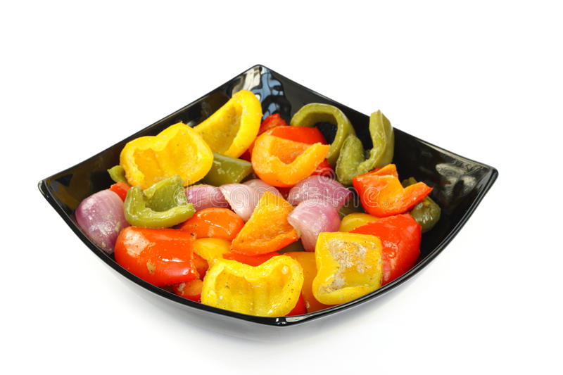 Delicious roasted capsicum and onion. Roasted different color capsicum and onion stock image