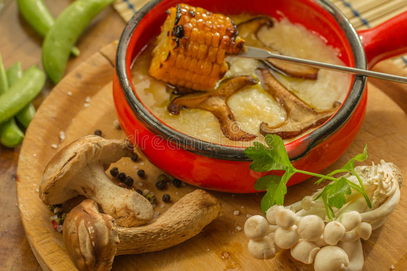 Delicious roasted maize with mushrooms stock photography