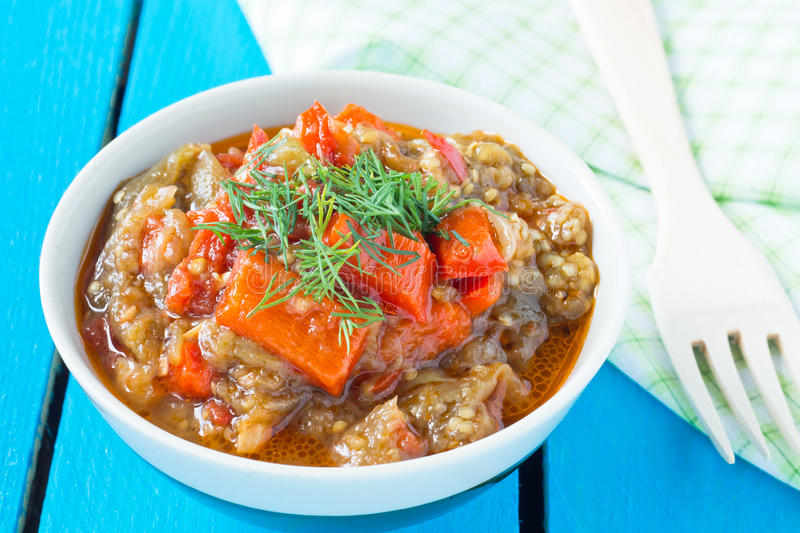 Delicious roasted red pepper and eggplant dish. Traditional relish from the Balkans royalty free stock images