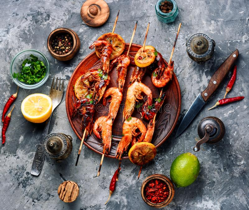 Grilled shrimp skewers stock photography