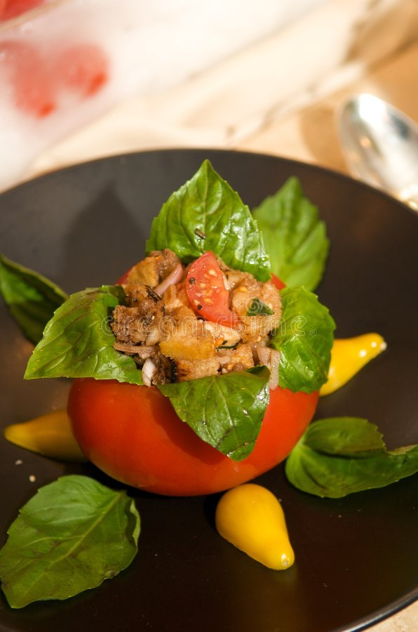 Delicious roma tomato stuffed with basil and chick royalty free stock photos