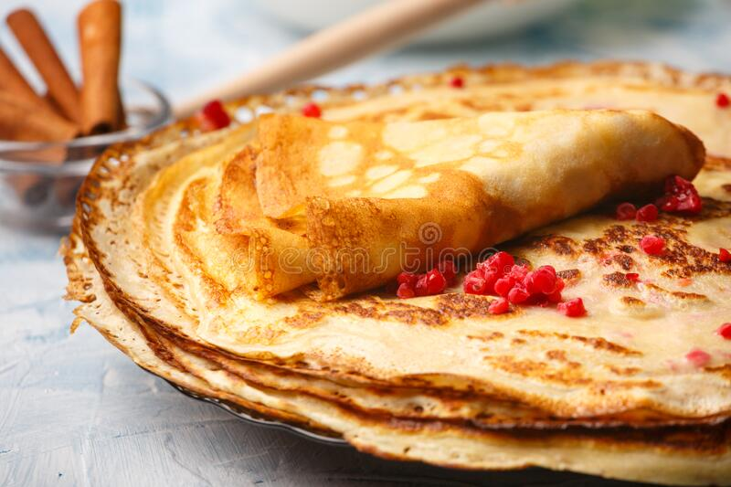 Delicious Russian pancakes with sour cream and honey cooked stock images