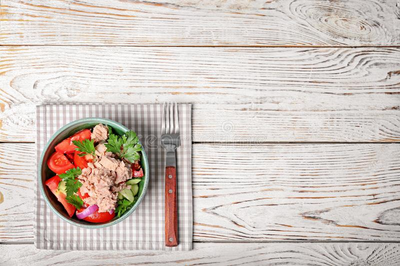 Delicious salad with canned tuna in bowl stock images