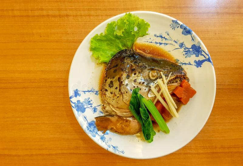Delicious Salmon head boiled in Soy sauce served on Japanese style dish royalty free stock images