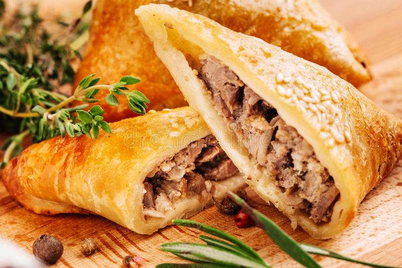 Delicious samosa pies with meat on plate. Menu, restaurant, recipe concept. Served in traditional oriental restaurant. Selected focus royalty free stock photography