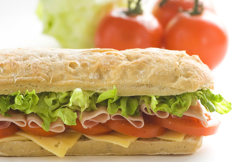 Delicious sandwich of ham cheese lettuce tomato stock photography