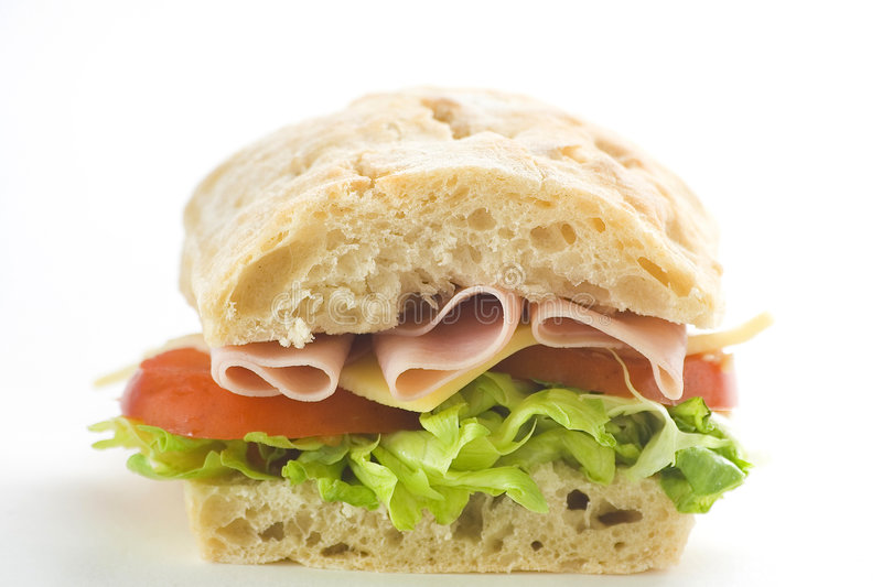 Delicious sandwich of ham cheese lettuce tomato royalty free stock photography