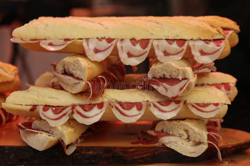 Smiley prosciutto in the sandwich royalty free stock image