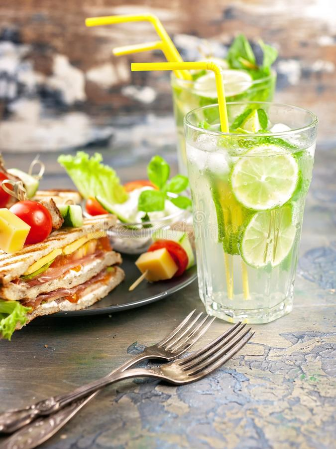 Delicious sandwiches and homemade lemonade. Drinks and snacks. Vertical shot stock photography