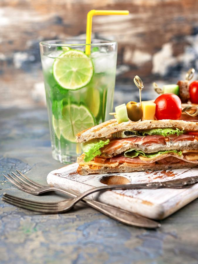 Delicious sandwiches and homemade lemonade. Drinks and snacks. Vertical shot royalty free stock images