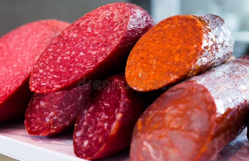 Delicious sausage at shop window. Delicious tasty sausage at shop window stock images