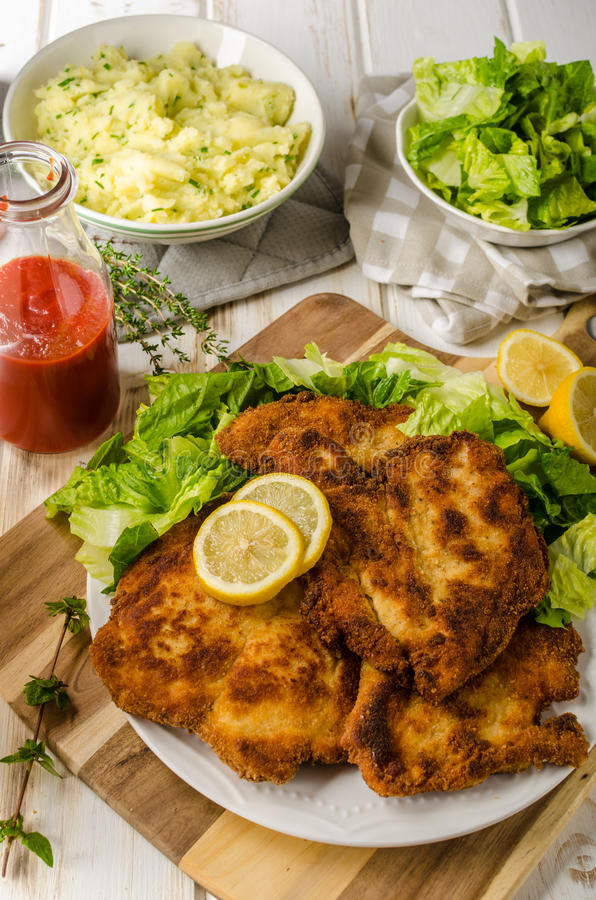 Delicious schnitzel with salad. Mashed potatoes, homemade ketchup stock photo
