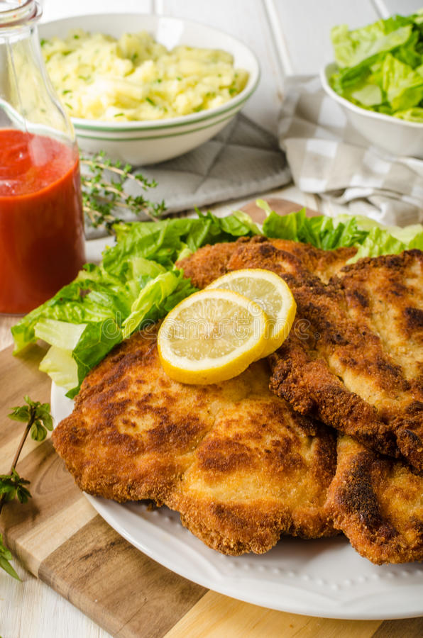 Delicious schnitzel with salad. Mashed potatoes, homemade ketchup royalty free stock photo