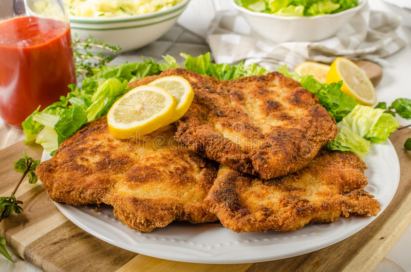 Delicious schnitzel with salad. Mashed potatoes, homemade ketchup royalty free stock image