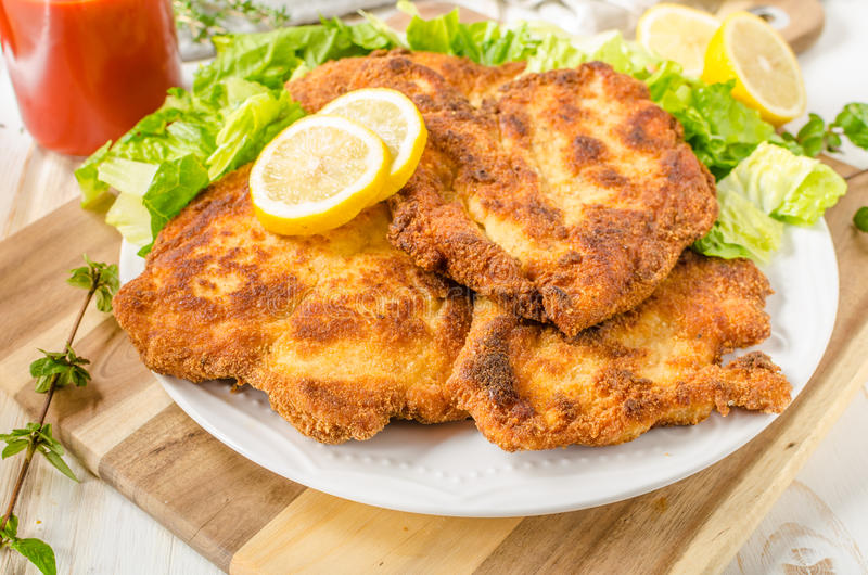 Delicious schnitzel with salad. Mashed potatoes, homemade ketchup royalty free stock images
