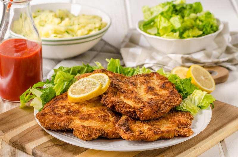 Delicious schnitzel with salad. Mashed potatoes, homemade ketchup royalty free stock photos