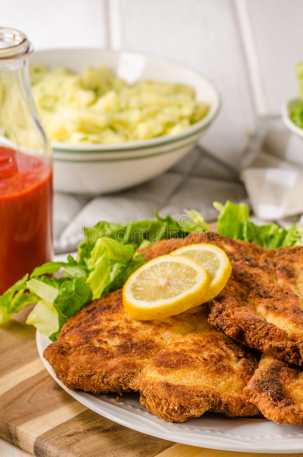 Delicious schnitzel with salad. Mashed potatoes, homemade ketchup stock images