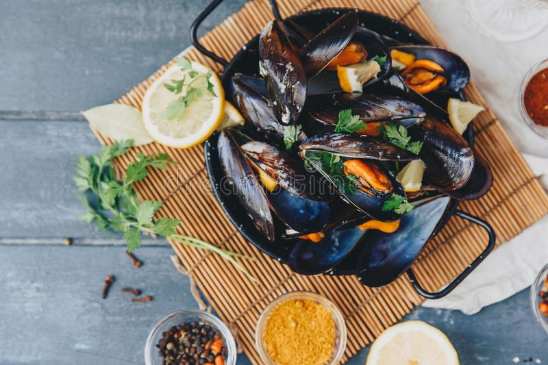 Delicious seafood fresh mussels with spices royalty free stock photo
