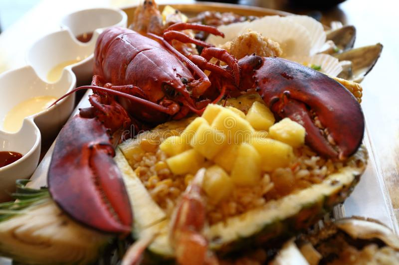 Delicious Seafood including lobster, scallop, shrimp, pineapple, fried rice in Jeju, Korea. Delicious Seafood including lobster, scallop, pineapple, fried rice royalty free stock photos