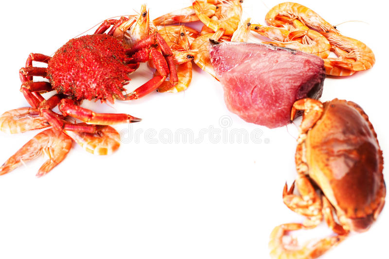 Delicious seafood - Red crab and tuna steak on white plate isol royalty free stock photo