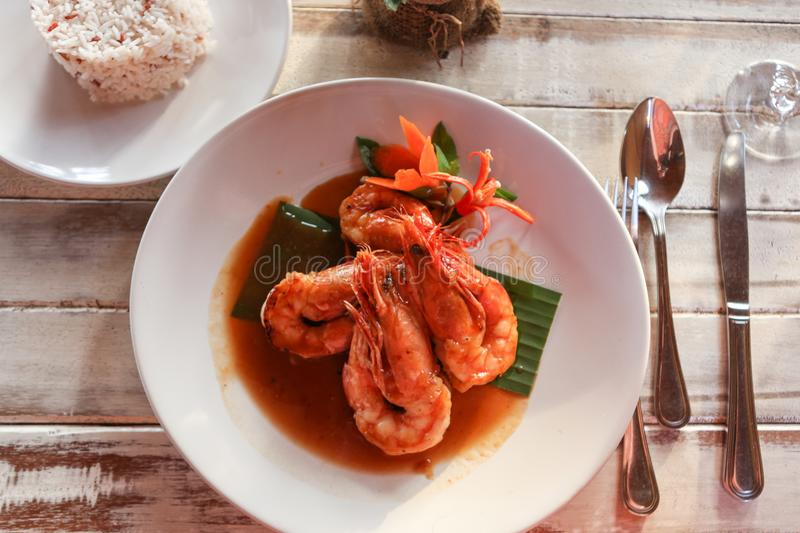 Delicious seafood shrimp prawn plate served in a fance restaurant. With chef sauce stock photo