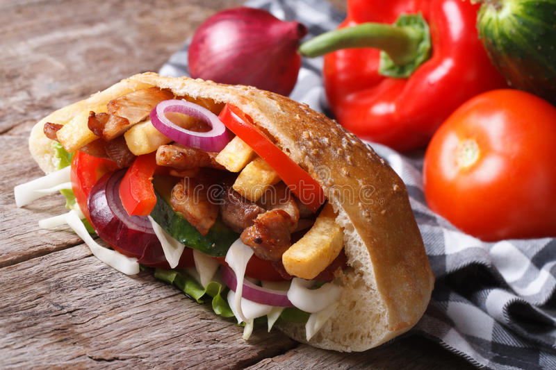 Delicious shawarma with meat, vegetables and fries in pita royalty free stock photos
