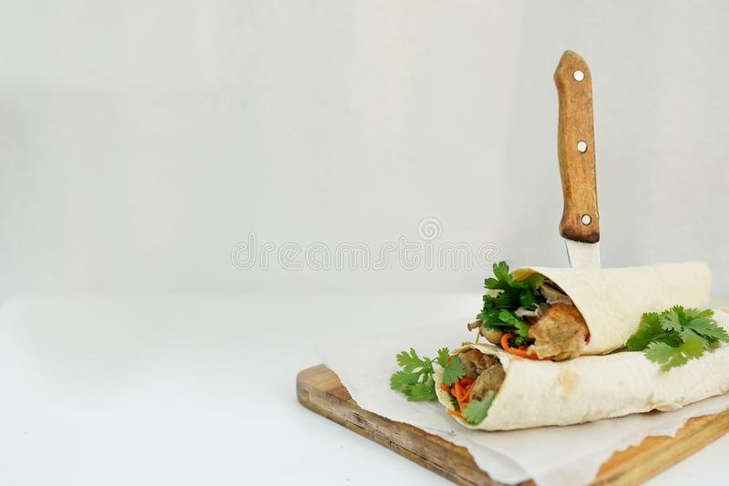 Delicious shawarma sandwich kebab on white background with space for text. fast food royalty free stock images