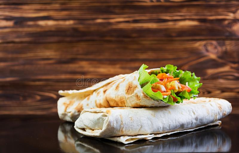 Delicious shawarma sandwich on wooden background stock photo