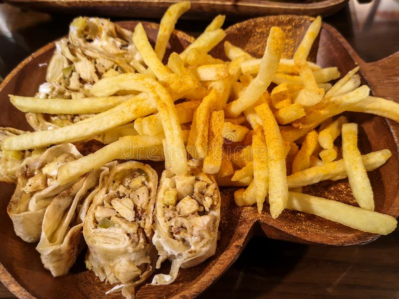 Delicious shawarma on wooden background - Eastern food and fries royalty free stock photos