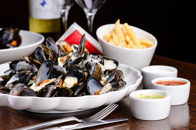 Delicious Shellfish Traditional Mussels with sour cream sauce on stock photo